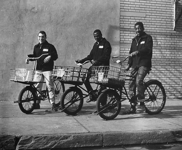 1950s archive photograph of delivery boys on bicycles